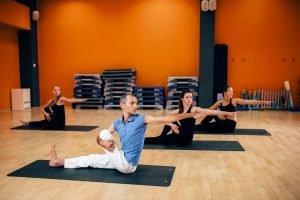 Yoga training class, female group workout